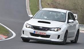 The new WRX winging it on the corner at Nurburgring.