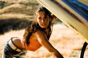 Long loose hair, crop top, short shorts... and not a spanner in sight.  The perfect outfit for repairing cars.