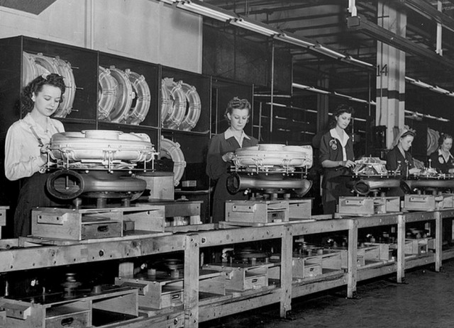 Rosie the Riveter and friends making Tin Lizzies on the Ford production line.