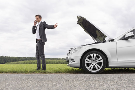 man-on-phone-with-broken-down-car-main