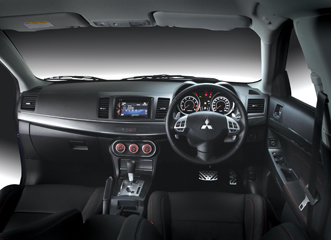 A glimpse of the Mitsubishi Lancer Sportback VRX interior. Modern materials and blue lighting look very nice.