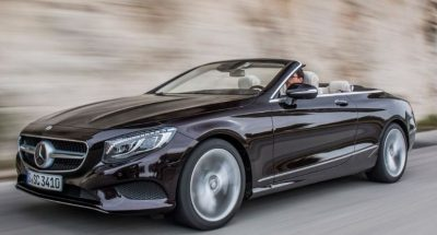 Side view of Mercedes Benz 2017 S Class Cabriolet , going fast the way it's supposed to.